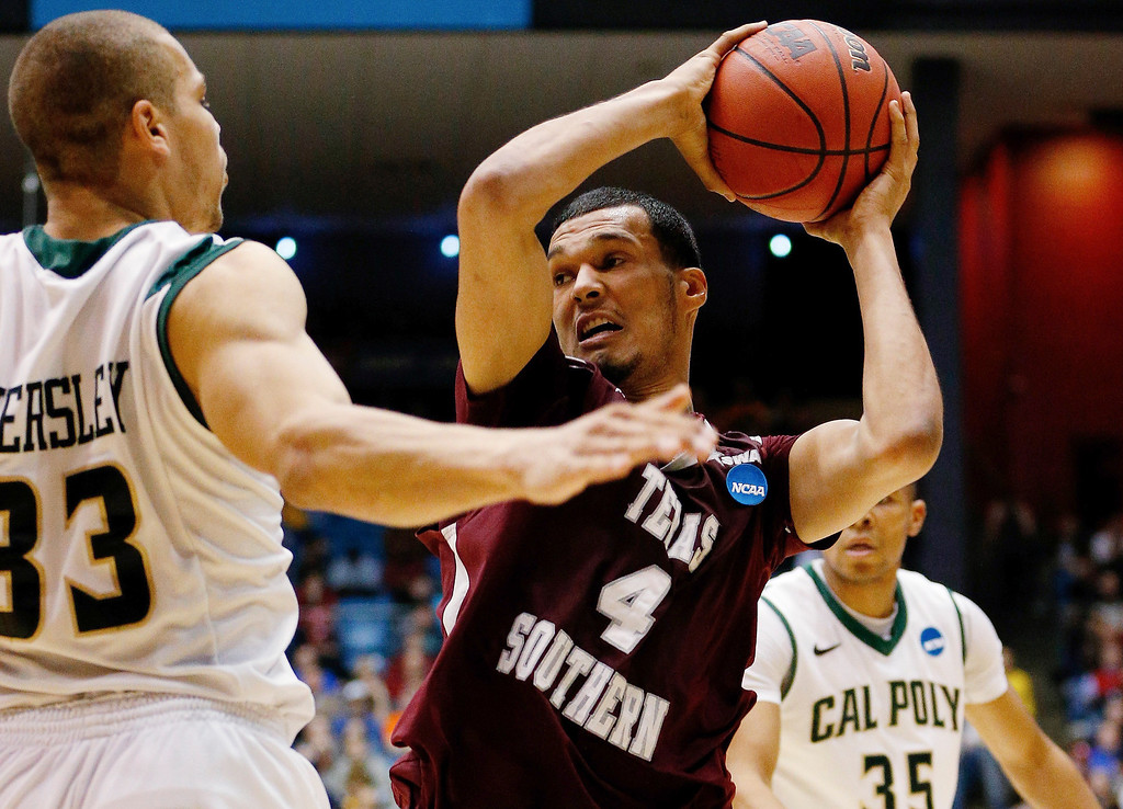 . Jose Rodriguez #4 of the Texas Southern Tigers drives to the basket as Chris Eversley #33 of the Cal Poly Mustangs defends during the first round of the 2014 NCAA Men\'s Basketball Tournament at UD Arena on March 19, 2014 in Dayton, Ohio.  (Photo by Gregory Shamus/Getty Images)