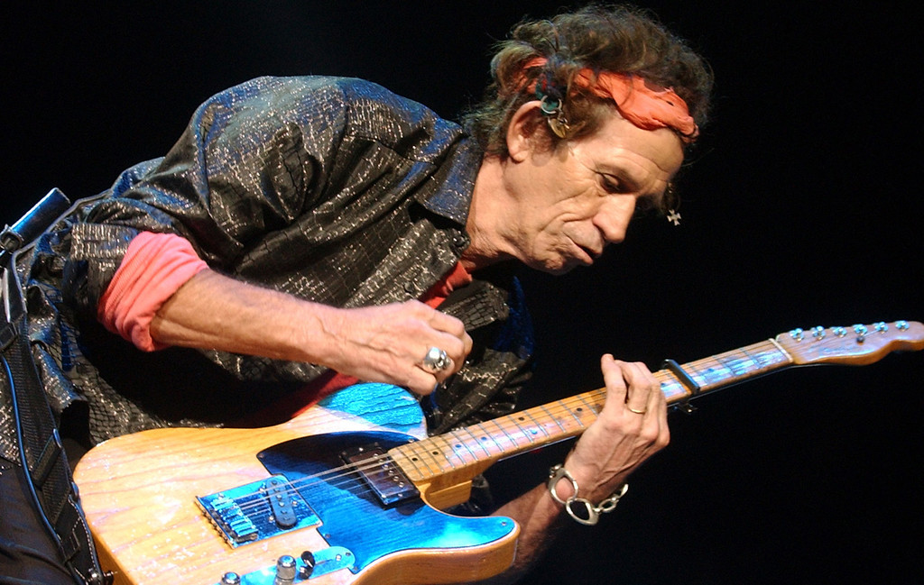 """. Rolling Stones\' Keith Richards performs during the \""""Licks\"""" world tour 2002-2003, Thursday, Sept. 26. 2002, in New York. (AP Photo/Mark Lennihan)"""