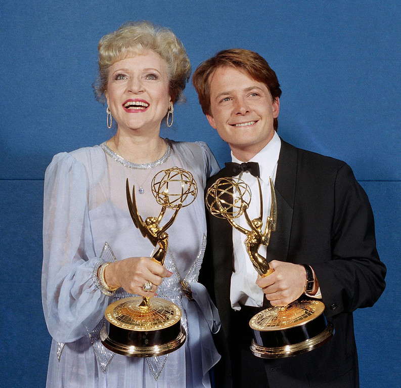 . Michael J. Fox and Betty White, winners of Emmys for best actor and actress in a comedy series, stand backstage at the Pasadena Civic Auditorium in Pasadena, California, Sunday, Sept. 21, 1986 after receiving their honors. Fox won for his role in ?Family Ties;? Ms. White for her role in ?The Golden Girls.? (AP Photo/Douglas C. Pizac)