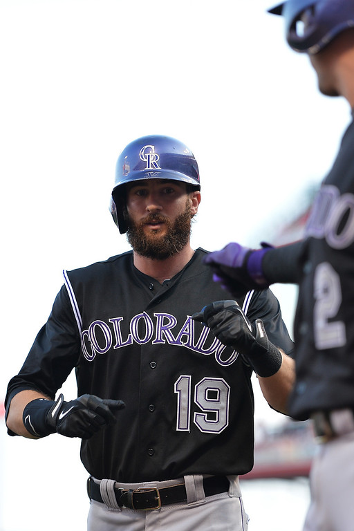 . CINCINNATI, OH - MAY 10:  Charlie Blackmon #19 of the Colorado Rockies celebrates his lead off home run in the first inning against the Cincinnati Reds at Great American Ball Park on May 10, 2014 in Cincinnati, Ohio.  (Photo by Jamie Sabau/Getty Images)
