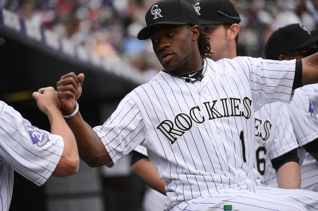 . Eric Young (1) of the Colorado Rockies fist bumps a teammate before the start of the game. (Photo by Hyoung Chang/The Denver Post)