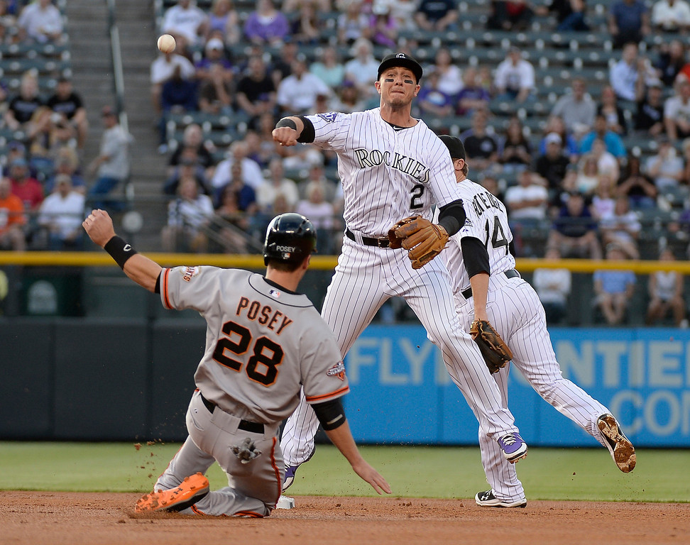 . Troy Tulowitzki (2) of the Colorado Rockies gets the force on Buster Posey (28) of the San Francisco Giants and doubles up Hunter Pence at first base during the second inning May 16, 2013 at Coors Field. (Photo By John Leyba/The Denver Post)