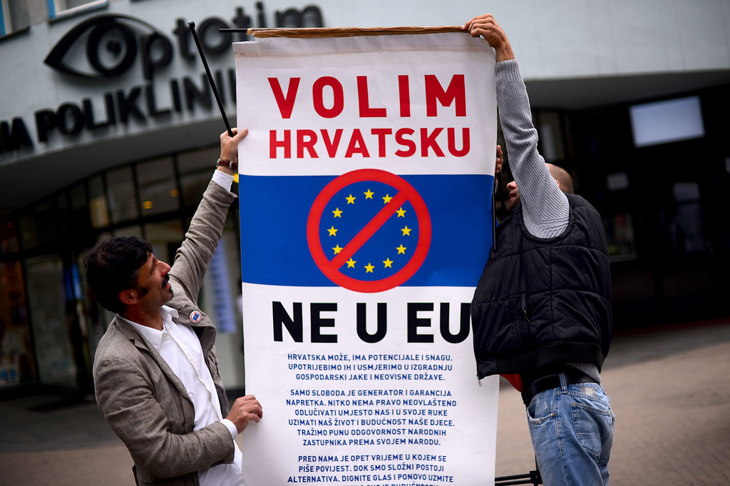 """. Croatian demonstrators display a poster reading \""""We like Croatia, No in EU\"""" during a protest against the entry of Croatia in the European Union in downtown Zagreb on June 29, 2013. Croatia will become on July 1, 2013 the 28th country to enter the European Union.  DIMITAR DILKOFF/AFP/Getty Images"""