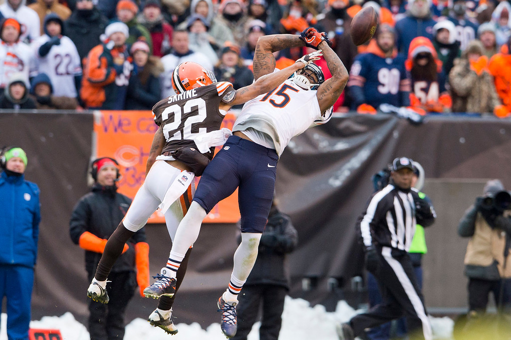 . Cornerback Buster Skrine #22 of the Cleveland Browns breaks up a pass to wide receiver Brandon Marshall #15 of the Chicago Bears during the second half at FirstEnergy Stadium on December 15, 2013 in Cleveland, Ohio. The Bears defeated the Browns 38-31. (Photo by Jason Miller/Getty Images)