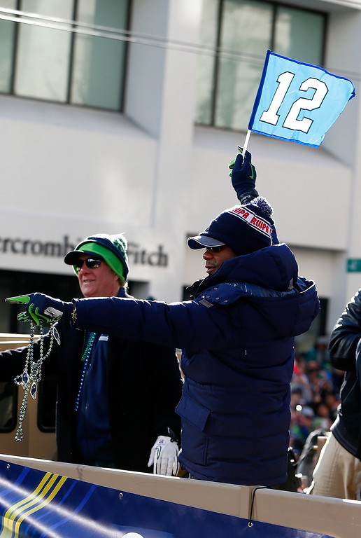 . Russell Wilson #3 of the Seattle Seahawks celebrates their victory in Super Bowl XLVII during a parade on February 5, 2014 in Seattle, Washington.  (Photo by Jonathan Ferrey/Getty Images)