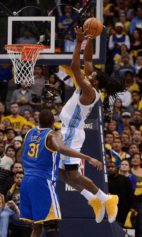 . Denver Nuggets small forward Kenneth Faried (35) goes up for a dunk over Golden State Warriors center Festus Ezeli (31) in the fourth quarter. The Denver Nuggets took on the Golden State Warriors in Game 5 of the Western Conference First Round Series at the Pepsi Center in Denver, Colo. on April 30, 2013. (Photo by John Leyba/The Denver Post)
