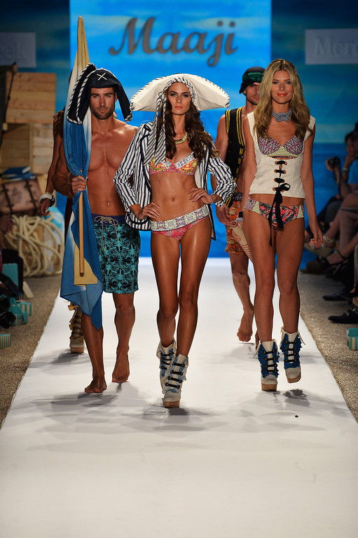. A model walks the runway at the Maaji Swimwear show during Mercedes-Benz Fashion Week Swim 2014 at Cabana Grande at the Raleigh on July 21, 2013 in Miami, Florida.  (Photo by Frazer Harrison/Getty Images for Maaji Swimwear)
