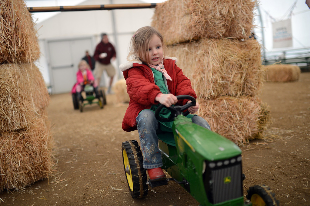. Sawyer, 4, from Park Hill Children Center is pedaling during the tractor race at Ames Activity Pavilion of 2013 National Western Stock Show on Tuesday. Denver. CO, January 15, 2013.  Hyoung Chang, The Denver Post