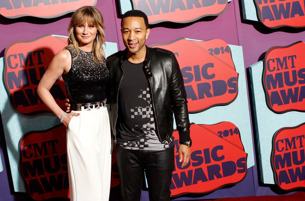 . Jennifer Nettles, left, and John Legend arrive at the CMT Music Awards at Bridgestone Arena on Wednesday, June 4, 2014, in Nashville, Tenn. (Photo by Wade Payne/Invision/AP)