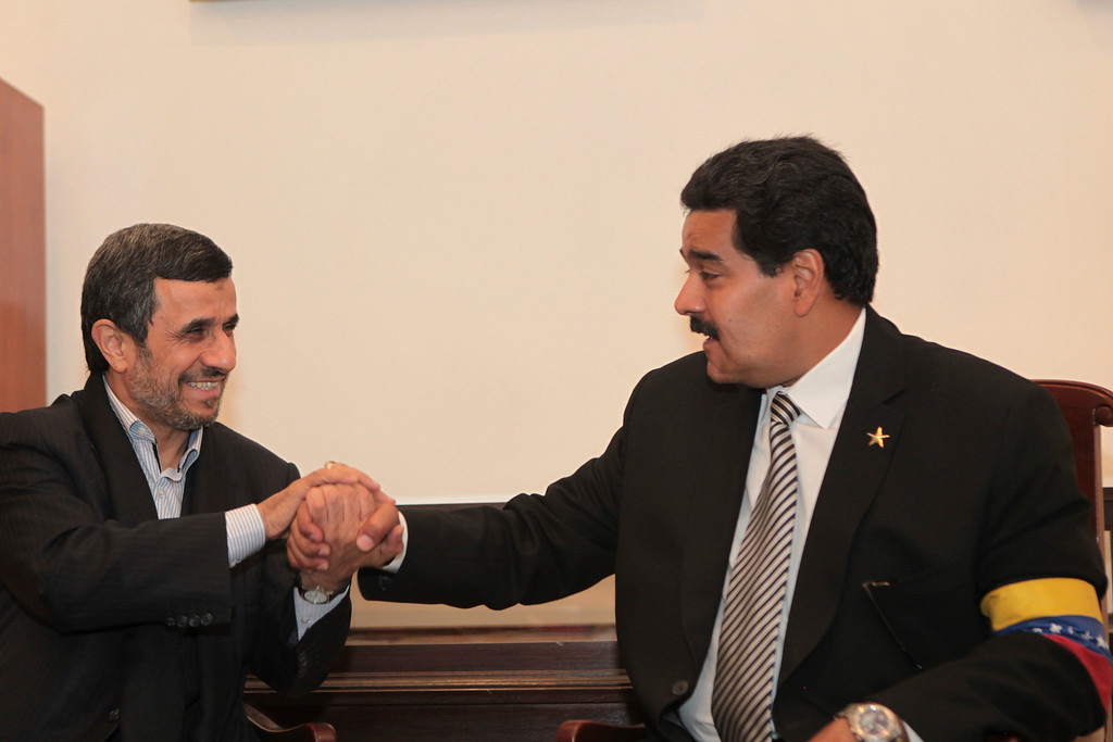 . Venezuelan Vice-President Nicolas Maduro (R) talks with Iran\'s President Mahmoud Ahmadinejad after the funeral for late President Hugo Chavez at the Military Academy in Caracas March 8, 2013, in this picture provided by the Miraflores Palace. REUTERS/Miraflores Palace/Handout