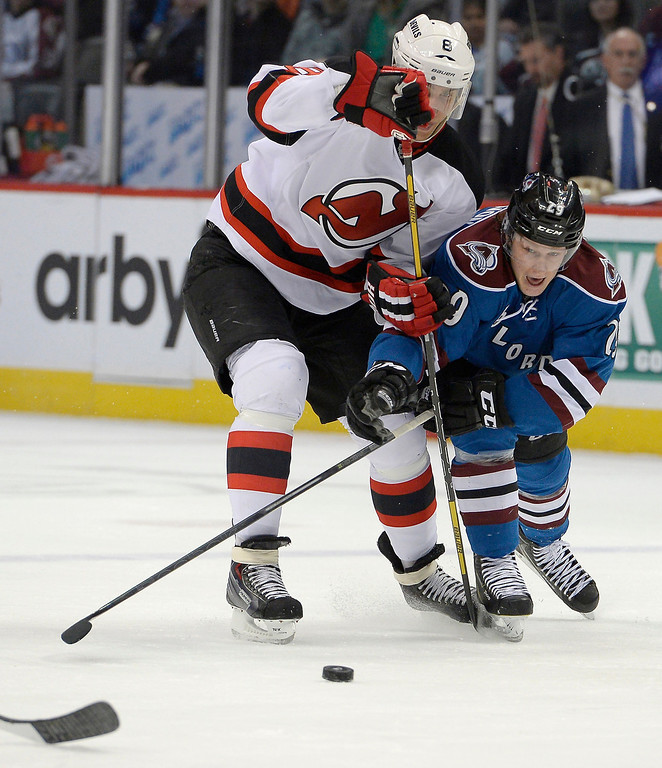 . New Jersey Devils right wing Dainius Zubrus (8) pushes off Colorado Avalanche center Nathan MacKinnon (29) from the puck during the first period January 16, 2014 at Pepsi Center. (Photo by John Leyba/The Denver Post)