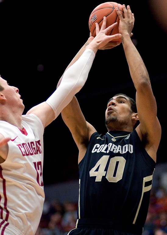 . Colorado forward Josh Scott (40) shoots over Washington State forward Brock Motum (12) during the first half of an NCAA college basketball game Saturday, Jan. 19, 2013, in Pullman, Wash. (AP Photo/Dean Hare)