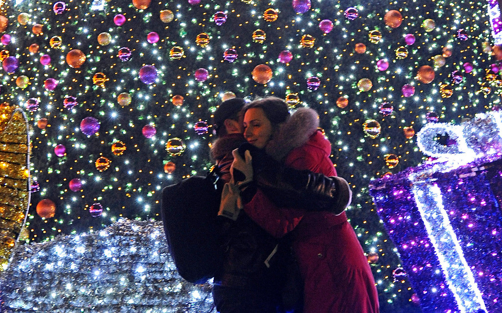 . A couple celebrates the New Year\'s Eve in the Old Town in Warsaw, Poland, Wednesday, Jan. 1, 2014. (AP Photo/Alik Keplicz)