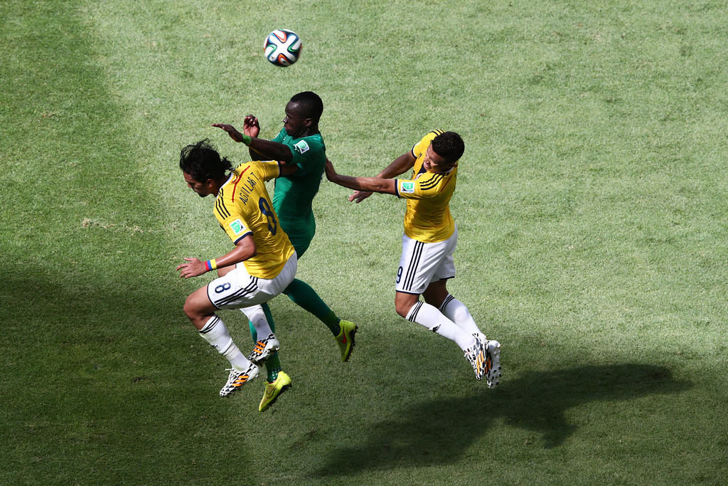 . Cheick Tiote of the Ivory Coast goes up for a header against Abel Aguilar (L) and Teofilo Gutierrez of Colombia during the 2014 FIFA World Cup Brazil Group C match between Colombia and Cote D\'Ivoire at Estadio Nacional on June 19, 2014 in Brasilia, Brazil.  (Photo by Adam Pretty/Getty Images)