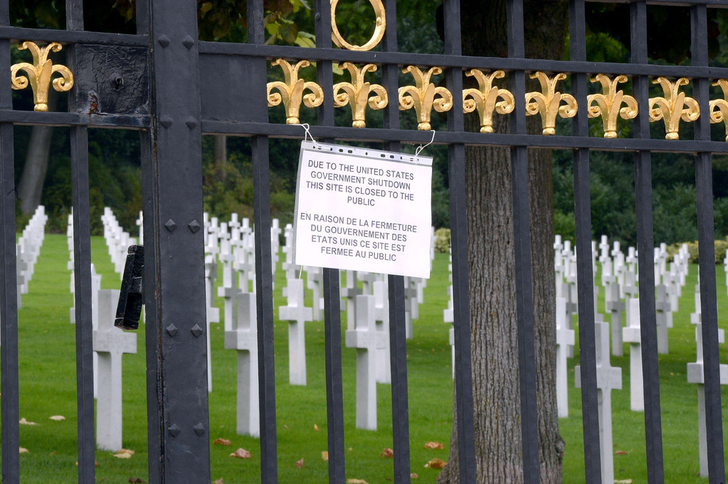 . A board informs visitors of the closing of the Suresnes American Cemetery and Memorial, west of Paris, on October 1, 2013, after US Congress was unable to agree on a federal budget and shut down for the first time in 17 years. Ten minutes before midnight on September 30, 2013, the White House budget office issued an order for many government departments to start closing down, triggering 800,000 furloughs of federal workers, and shutting tourists out of  national parks and museums. AFP PHOTO PIERRE  ANDRIEU/AFP/Getty Images
