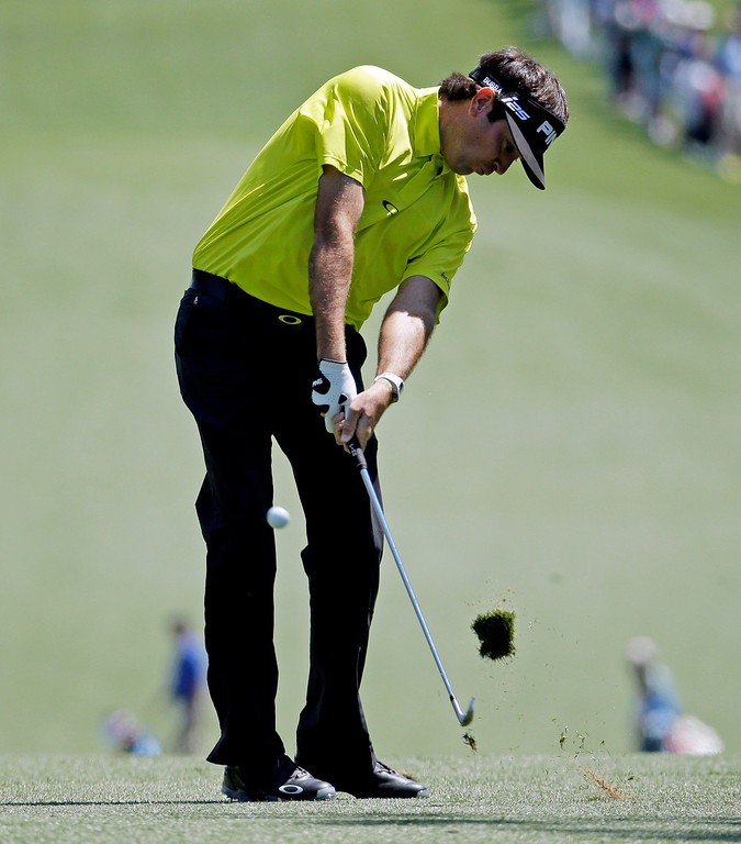 . Bubba Watson hits off the first fairway during the first round of the Masters golf tournament Thursday, April 10, 2014, in Augusta, Ga. (AP Photo/Charlie Riedel)