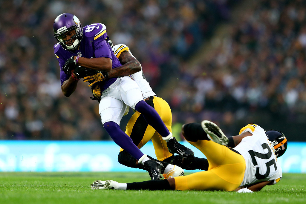 . LONDON, ENGLAND - SEPTEMBER 29:  Wide receiver Jerome Simpson #81 of the Minnesota Vikings is tackled by cornerback Ike Taylor #24 of the Pittsburgh Steelers during the NFL International Series game between Pittsburgh Steelers and Minnesota Vikings at Wembley Stadium on September 29, 2013 in London, England.  (Photo by Michael Steele/Getty Images)
