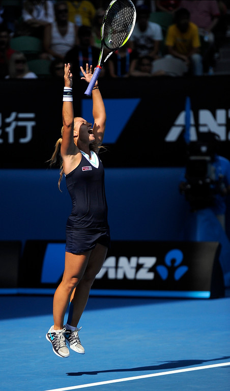 . Dominika Cibulkova of Slovakia celebrates after defeating  Agnieszka Radwanska of Poland during their semifinal at the Australian Open tennis championship in Melbourne, Australia, Thursday, Jan. 23, 2014.(AP Photo/Andrew Brownbill)