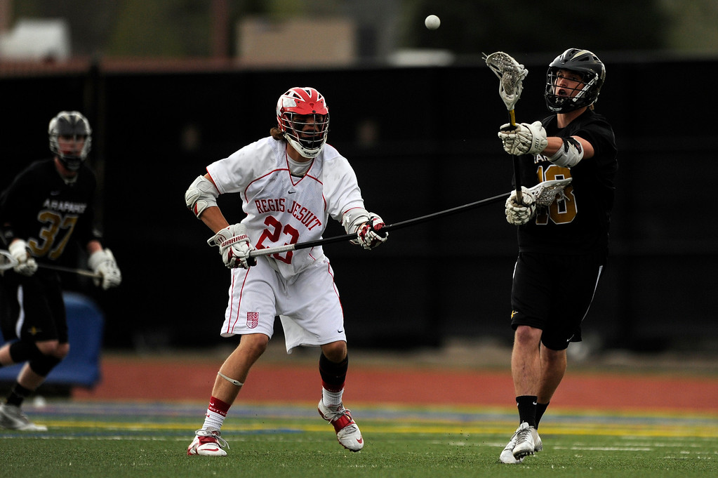 . DENVER, CO - MAY 15: Arapahoe senior midfielder John-Morgan Finley #18 passes the ball while defended by Regis Jesuit senior defenseman Justin Finley #23 during a CHSAA 5A boys lacrosse semifinal game on May 15, 2013, in Denver, Colorado. Arapahoe won 13-5 to advance to the finals. (Photo by Daniel Petty/The Denver Post)
