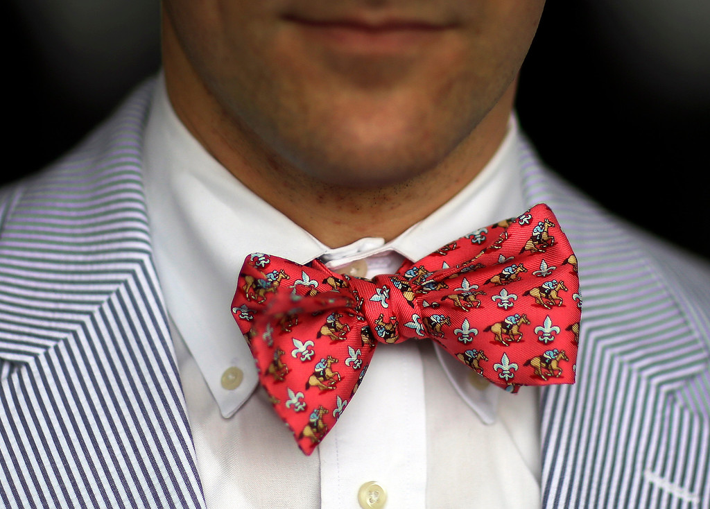 . Spectator Bill Norris sports a horse-themed bow tie at Pimlico Race Course in Baltimore, Saturday, May 18, 2013, before the 138th running of the Preakness Stakes horse race. (AP Photo/Patrick Semansky)