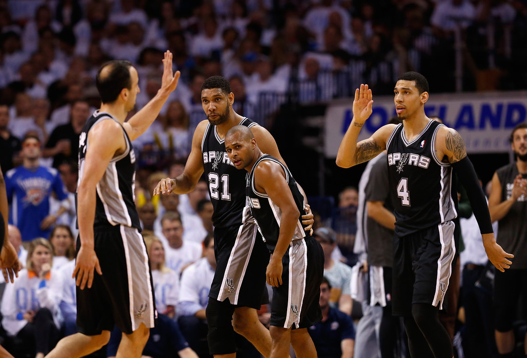 . OKLAHOMA CITY, OK - MAY 31:  Manu Ginobili #20 and Danny Green #4  of the San Antonio Spurs celebrate with their teammates after a play against the Oklahoma City Thunder in the second half during Game Six of the Western Conference Finals of the 2014 NBA Playoffs at Chesapeake Energy Arena on May 31, 2014 in Oklahoma City, Oklahoma. (Photo by Ronald Martinez/Getty Images)