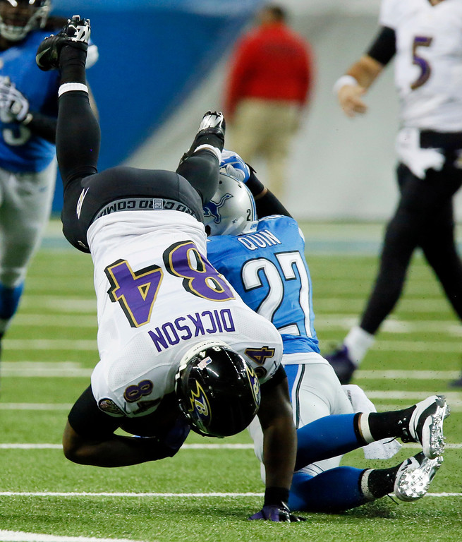 . Baltimore Ravens tight end Ed Dickson (84) is upended by Detroit Lions strong safety Glover Quin (27) during the second quarter of an NFL football game in Detroit, Monday, Dec. 16, 2013. (AP Photo/Duane Burleson)