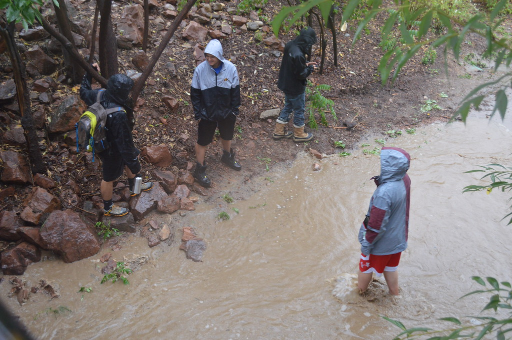 . After sirens sounded alerting citizens to an impending flood at Boulder Creek, some curious onlookers headed towards the creek to witness the flood first-hand. Photo by Natalie Boyd