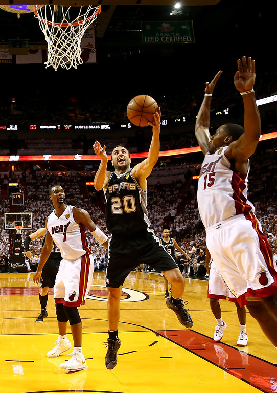 . MIAMI, FL - JUNE 12:  Manu Ginobili #20 of the San Antonio Spurs goes to the basket against Mario Chalmers #15 of the Miami Heat defends during Game Four of the 2014 NBA Finals at American Airlines Arena on June 12, 2014 in Miami, Florida. (Photo by Andy Lyons/Getty Images)