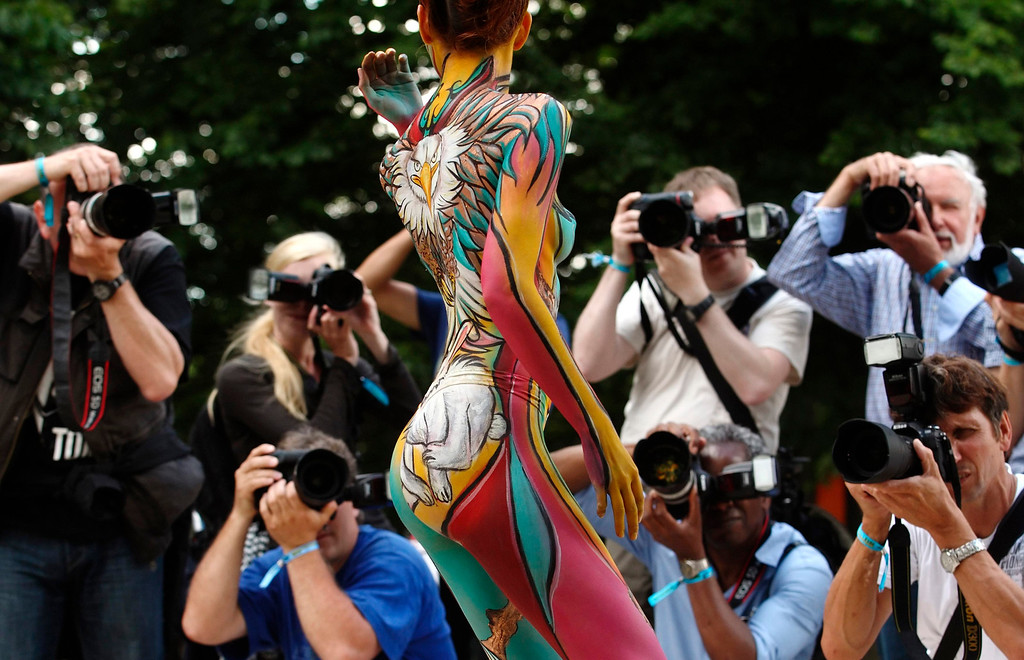 . A model poses for photographers during the annual World Bodypainting Festival in Poertschach July 5, 2013. The world\'s biggest bodypainting event takes place from July 5 to 7 at lake Woerthersee in Austria\'s southern Carinthia province. REUTERS/Heinz-Peter Bader