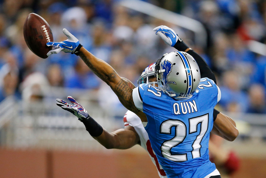 . Detroit Lions strong safety Glover Quin (27) breaks up a pass intended for New York Giants wide receiver Rueben Randle during the second quarter of an NFL football game, Sunday, Dec. 22, 2013, in Detroit. (AP Photo/Rick Osentoski)