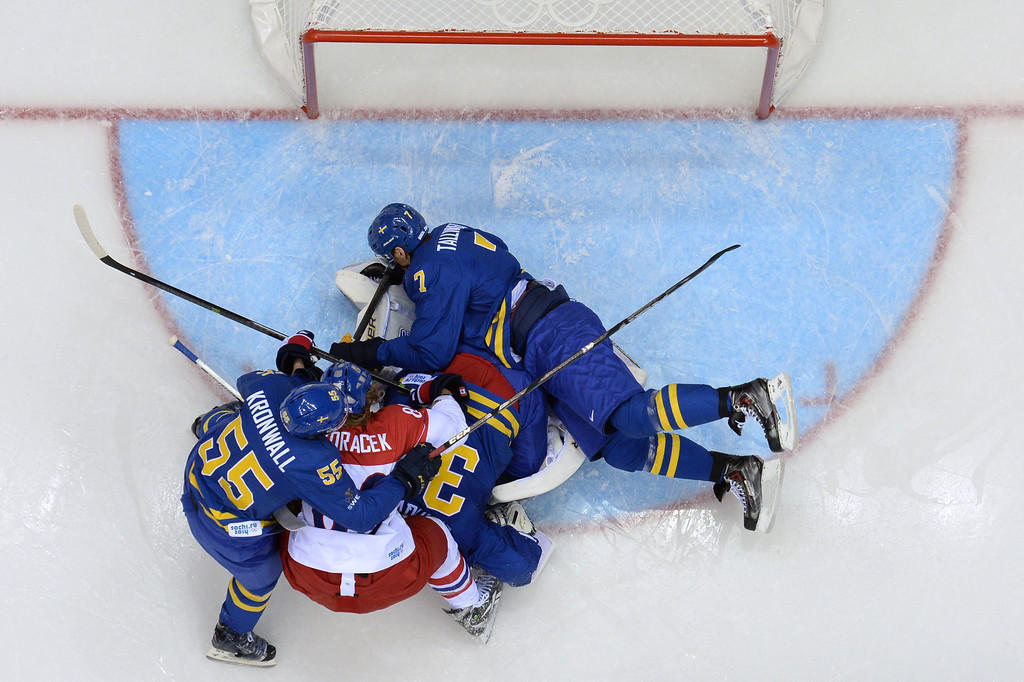 . Sweden\'s goalkeeper Henrik Lundqvist (C), Sweden\'s Henrik Tallinder (top) and Sweden\'s Niklas Kronwall (L) fight for the puck with Czech Republic\'s Jakub Voracek (2ndL) during the Men\'s Ice Hockey Group B match Czech Republic vs Sweden at the Bolshoy Ice Dome on February 12, 2014 at the Sochi Winter Olympics in Sochi.   ALEXANDER NEMENOV/AFP/Getty Images