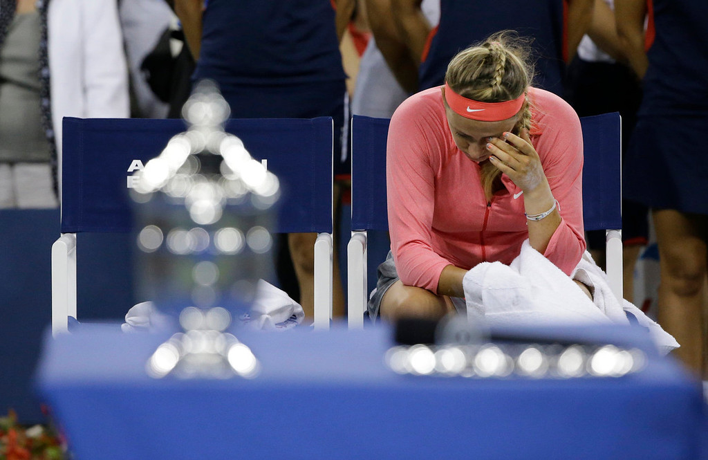 . Victoria Azarenka, of Belarus, sits at court side before the trophy presentation after losing to Serena Williams in the women\'s singles final of the 2013 U.S. Open tennis tournament, Sunday, Sept. 8, 2013, in New York. (AP Photo/David Goldman)