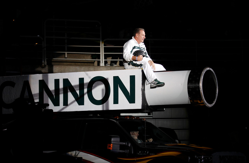. Michigan State coach Tom Izzo makes his entrance on top of a cannon before an NCAA college basketball scrimmage, Friday, Oct. 18, 2013, in East Lansing, Mich. (AP Photo/Al Goldis)