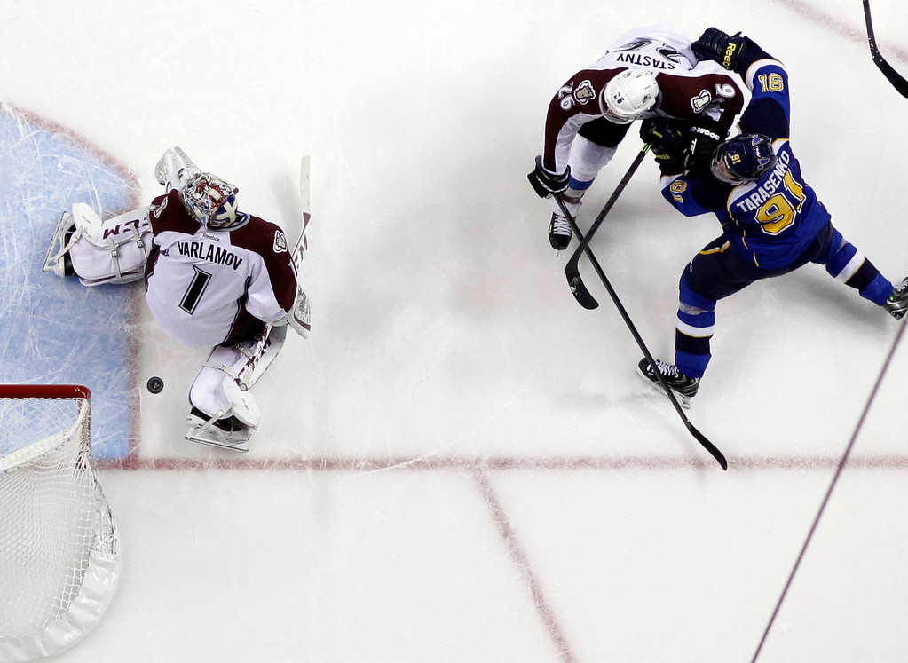 . A shot by St. Louis Blues\' Vladimir Tarasenko (91), of Russia, slips past Colorado Avalanche goalie Semyon Varlamov, left, also of Russia, as the Avalanche\'s Paul Stastny (26) watches during the second period of an NHL hockey game Thursday, Nov. 14, 2013, in St. Louis. (AP Photo/Jeff Roberson)