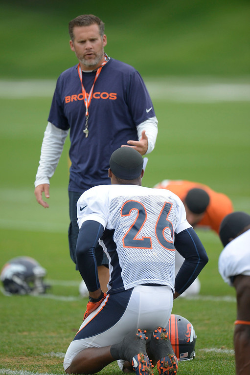 . Denver Broncos special team coordinator Jeff Rodgers talks with Denver Broncos free safety Rahim Moore (26) before practice September 1, 2013 at Dove Valley. (Photo by John Leyba/The Denver Post)