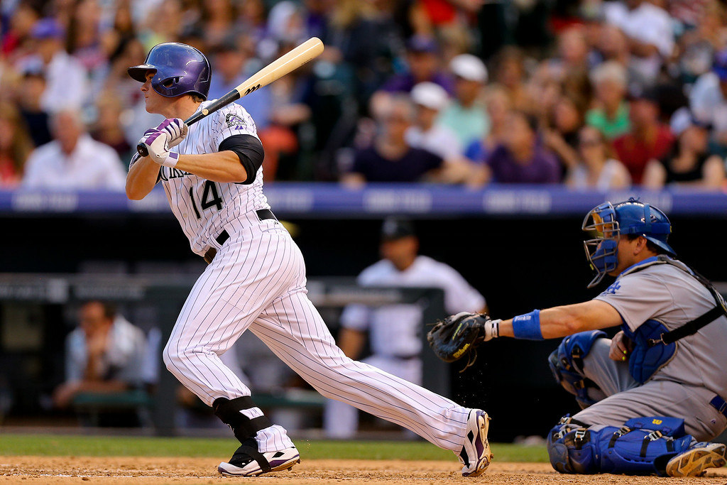 . Josh Rutledge #14 of the Colorado Rockies watches his pinch hit RBI double during the fifth inning against the Los Angeles Dodgers at Coors Field on July 3, 2014 in Denver, Colorado. The Dodgers defeated the Rockies 3-2. (Photo by Justin Edmonds/Getty Images)