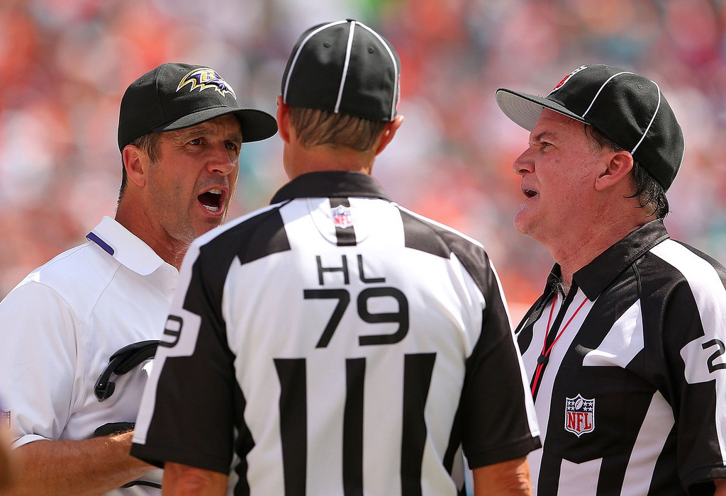 . Baltimore Ravens head coach John Harbaugh argues with referees during a game against the Miami Dolphins at Sun Life Stadium on October 6, 2013 in Miami Gardens, Florida.  (Photo by Mike Ehrmann/Getty Images)