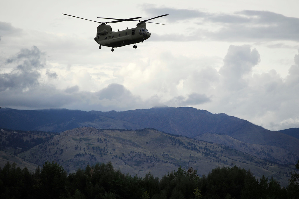 . BOULDER, CO - SEPTEMBER 13: A chinook helicopter approaches the Boulder Municipal Airport Friday afternoon, September 13, 2013 with Jamestown flood evacuees on board. (Photo By Andy Cross/The Denver Post)
