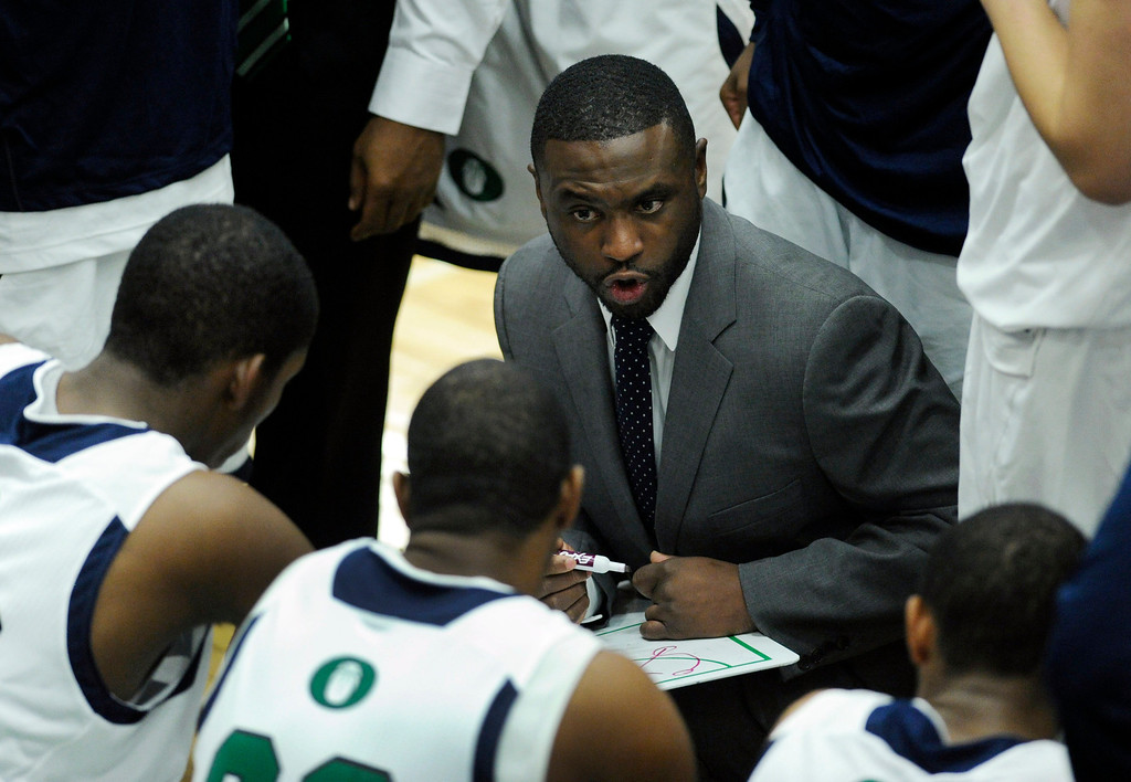 . Blazers head coach Danny Fisher led the team to a win Tuesday night. The Overland High School boy\'s basketball team defeated Regis Jesuit 80-66 Tuesday night, December 11, 2012.  Karl Gehring/The Denver Post