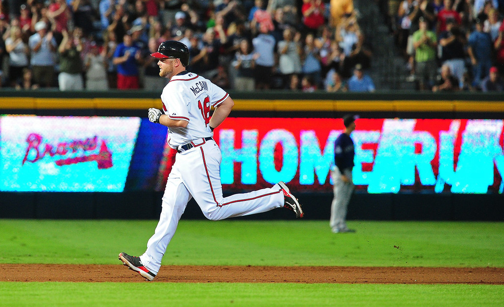 . Brian McCann #16 of the Atlanta Braves rounds the bases after hitting a fourth inning three run home run against the Colorado Rockies at Turner Field on July 30, 2013 in Atlanta, Georgia. (Photo by Scott Cunningham/Getty Images)