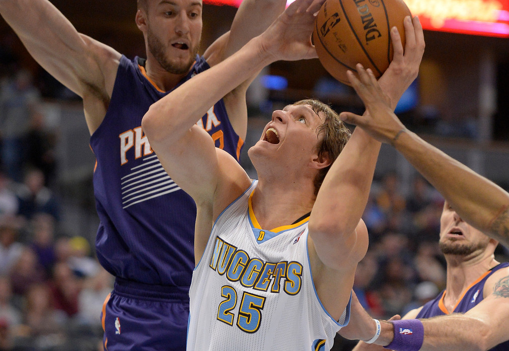 . Denver Nuggets center Timofey Mozgov (25) goes up for a shot surrounded by Phoenix Suns players during the first quarter October 23, 2013 at Pepsi Center. (Photo By John Leyba/The Denver Post)