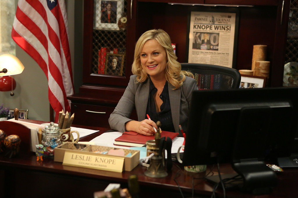 ". This image released by NBC shows Amy Poehler in a scene from ""Parks & Recreation.\"" Poehler was nominated for an Emmy Award for best actress in a comedy series on Thursday, July 10, 2014. The 66th Primetime Emmy Awards will be presented Aug. 25 at the Nokia Theatre in Los Angeles. (AP Photo/NBC, Dean Hendler)"