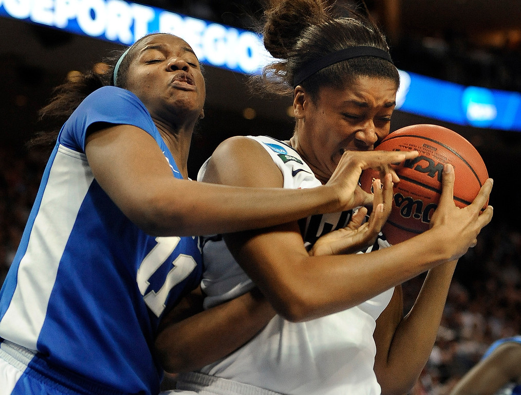 . Kentucky\'s DeNesha Stallworth, left, tangles with Connecticut\'s Morgan Tuck, right, during the second half of a women\'s regional final game in the NCAA college basketball tournament in Bridgeport, Conn., Monday, April 1, 2013. Connecticut won 83-53.(AP Photo/Jessica Hill)
