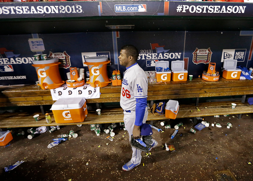 . Los Angeles Dodgers\' Yasiel Puig walks out of the dugout after Game 6 of the National League baseball championship series against the St. Louis Cardinals, Friday, Oct. 18, 2013, in St. Louis. The Cardinals won 9-0 to win the series. (AP Photo/David J. Phillip)