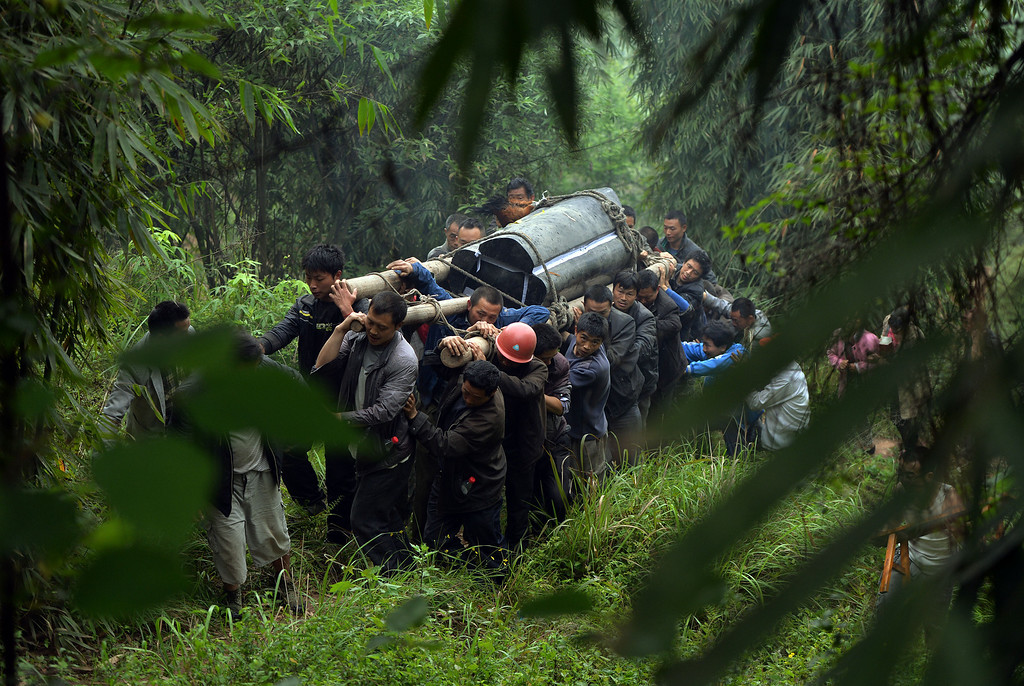 . Villagers carry the coffin of a man killed after a magnitude 7.0 earthquake hit Lushan, Sichuan Province on April 22, 2013.   AFP PHOTO/Mark  RALSTON/AFP/Getty Images