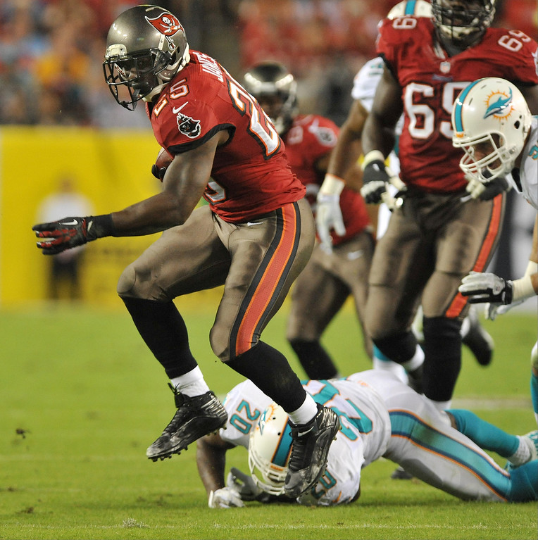 . Running back Mike James #25 of the Tampa Bay Buccaneers runs for a gain in the 1st quarter against the Miami Dolphins November 11, 2013 at Raymond James Stadium in Tampa, Florida. (Photo by Al Messerschmidt/Getty Images)