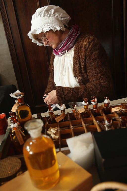 . Locals dressed in early-19th century regional period clothing make perfume and oils in a recreated 1813 village in Liebertwolkwitz district during events to commemorate the 200th anniversary of The Battle of Nations on October 16, 2013 in Leipzig, Germany.  (Photo by Sean Gallup/Getty Images)