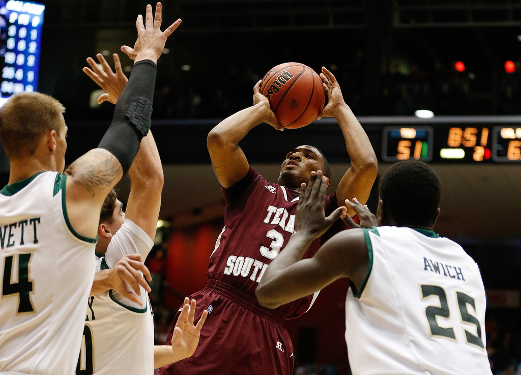 . Madarious Gibbs #3 of the Texas Southern Tigers takes a shot against the Cal Poly Mustangs during the first round of the 2014 NCAA Men\'s Basketball Tournament at UD Arena on March 19, 2014 in Dayton, Ohio.  (Photo by Gregory Shamus/Getty Images)