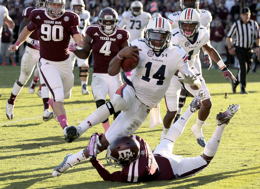 . Nick Marshall #14 of the Auburn Tigers rushes for a touchdown against the Texas A&M Aggies on October 19, 2013 at Kyle Field in College Station, Texas. Auburn Tigers won 45 to 41.(Photo by Thomas B. Shea/Getty Images)