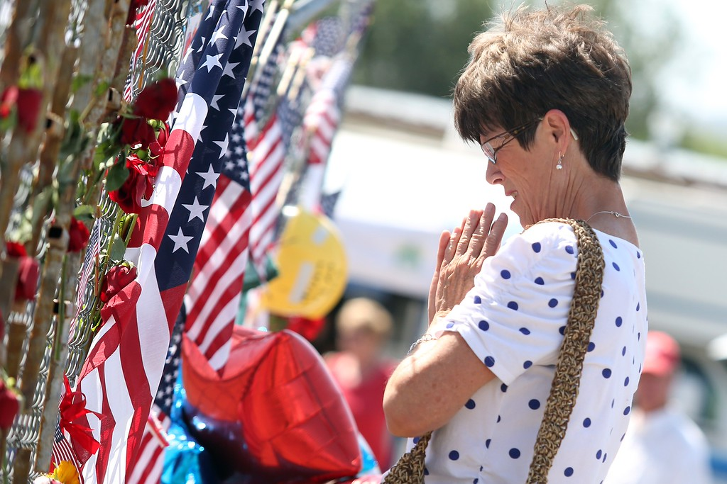 . Nancy Alder pays her respects at the memorial for the 19 fallen Granite Mountain Hotshot firefighters outside of fire station 7 in Prescott, Arizona July 2, 2013.  AFP PHOTO / KRISTA  Kennell/AFP/Getty Images